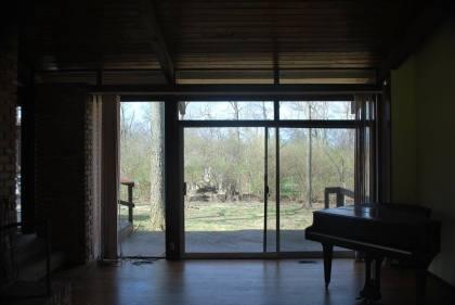 Livingroom sliding glass doors to backyard