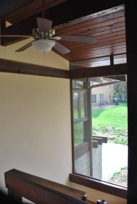 Oversized plate glass window toward neighboring yard