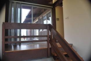 Hallway sliding door from basement steps