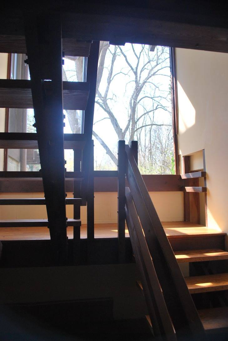 Plate glass window & floating stairs from basement